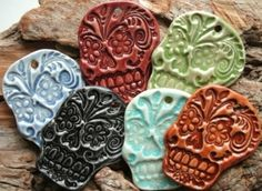 Green Sugar Skull Pendant  stoneware. $12.00, via Etsy.