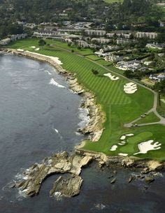 Hole 18 - Pebble Beach Golf Links. Many tournaments won and lost here. I wonder how many balls are along that shoreline...