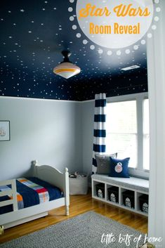 "What kid doesn't love staring up at a starry sky? Add in a window seat, storage for toys and a healthy dose of adorable ""Star Wars""-themed accents, and you have a bedroom theme idea that's sure to be a hit a home.  Featuring Sherwin-Williams Naval SW 6244 and Gray Screen SW 7071"