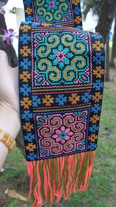 This unique cotton, cross-stitched, texitle fabric comes from the green Hmong hill tribe village located in Doi Pui National Park, Chiang Mai, Northern Thailand. This item measures 31 inches long by 5.5 inches width. One of our newest line of exquisitely, hand crafted, Hmong hill