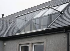 Balustrade solution for a loft on Islay, Scotland. Anodised aluminium handrail drills to the roof timbers and secures the Velux window opening with a frameless glass balustrade and two triangular glass side pan Loft Conversion Balcony, Dormer Loft Conversion, Loft Conversion Bedroom, Loft Conversions, Bungalow Loft Conversion, Loft Dormer, Dormer Roof, Dormer Windows, Attic Loft
