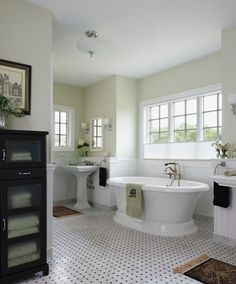 Traditional Black And White Marble Floors Accent This Old English Bathroom Appointed With Modern Amenities