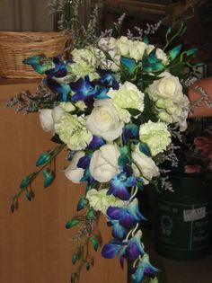 Cascade style bouquet with roses, dendrobium orchids and carnations. Orchid Bridal Bouquets, Orchid Flower Arrangements, Cascading Wedding Bouquets, Beach Wedding Flowers, Bridal Flowers, Flower Bouquet Wedding, Peacock Wedding, White Dendrobium Orchids, Purple Orchids
