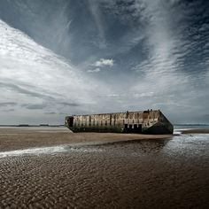 arromanches beach, normandie :: france. Part of the floating peir the allies floated for the invasion of France.