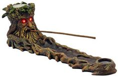 How awesome is this Greenman candle and Incense holder? This guy not only holds your stick incense, your cone incense AND a tea light candle, but his eyes light up as well! A switch on the bottom ligh