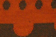 黒色×オレンジ色の生地。