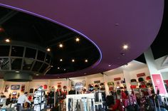 Garcia Architects designed this specialty ceiling above a cash wrap for a large luggage store chain