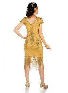 This Flapper Style Fringe Party Dress in Antique Gold recaptures the glamour of 1920's fashion. The classic scalloped sleeves and soft V-neck preserve the vintage look, while highlighting the modern fit. Gold Sequins, Flapper Style Dresses, Vintage Looks, Antique Gold, Hemline, Party Dress, Vintage Fashion, The Dress, Vintage Inspired