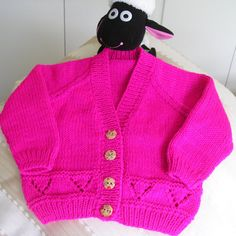 Strong 'girlie' pink baby cardigan - girl aged approximately 6 months (to fit 18in chest). Hand knit in a beautiful soft, natural yarn.