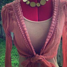 Bebe Pink Crochet Sheer Crop Too size Large Bell arms. Crochet trim. Crop top with front tie. Mauve pink. Small poofy shoulder. Size M/L. bebe Tops Crop Tops