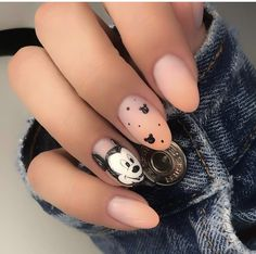 [UPDATED] Awesome Mickey Mouse Nail Designs (November Let the mouse become the focal point on your fingertips. Keep the rest of the nails a simple nude matte. Then go to town on the middle finge Ongles Mickey Mouse, Mickey Mouse Nail Design, Mickey Nails, Minnie Mouse Nails, Stylish Nails, Trendy Nails, Cute Nails, Disney Acrylic Nails, Best Acrylic Nails