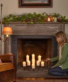 Add a low-maintenance glow to your fireplace with a large-scale candelabra. Nine-candle candelabra, about $65 from homedecorators.com | Photo: John Gruen | thisoldhouse.com