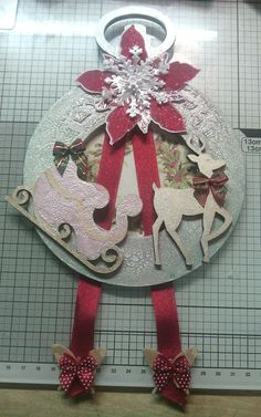 Made with mdf painted and spray and sparkle used. Decorated with mdf reindeer and sleigh and a few other embellishments.