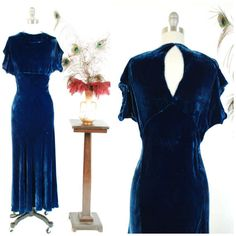 This vintage 1930s evening gown simply oozes Old Hollywood glamour. The cut is simple, the royal blue rayon velvet is rich and sultry, bias cut hugging your curves to a tee. The high neckline adds a demure touch to the otherwise bombshell silhouette. The sleek, classic 30s lines drape elegantly. This dress has no side closures, the bias cut allows for it to slip over your head nicely, but there is a hook at the the back of the neck. It comes with its original self-fabric bolero…
