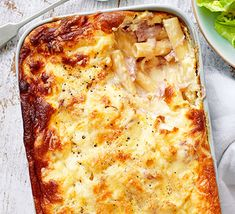 Soufflé mac 'n' cheese. Pasta bake is a firm family favourite - make this macaroni cheese even more indulgent with ham hock and chunks of cheddar