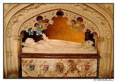Tomb of Queen Catherine Parr - the sixth and final wife of King Henry VIII. The crest emblems on the side of the tomb represent each of her five husbands. So Catherine had nearly as many husbands as Henry had wives.