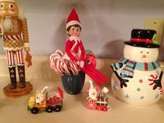Day 24, 2013 - Sprinkle is sitting in our candy canes and it looks like she started eating one - Elf on the Shelf Idea