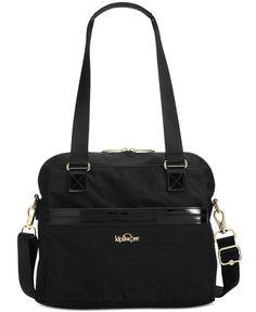 Glossy patent trim gives this lightweight Kipling satchel a sleek, city feel…