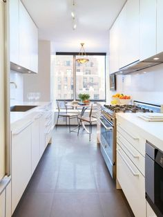 Kitchen:Marvelous Narrow White Galley Kitchen Design With Small Breakfast Area Also Modern White Kitchen Cabinet Including Kitchen Stove Ways to make a Long Narrow Kitchen feel Big