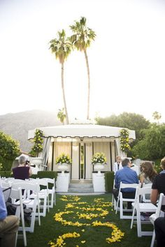 ceremony with a cabana backdrop. Cute!