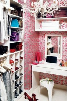 dressing room - love this idea for my closet! Chandeleir and adorable wallpaper!