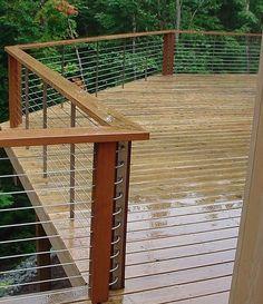 Love the horizontal metal rails, against the wood. Beautiful!