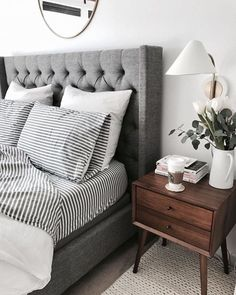 Enjoying @crystalinmarie's serene bedroom. Love the chic masculine appeal. The striped sheets with the tufted headboard are a fun combination. We found the headboard for just $400! http://ift.tt/2GP9AAY #CopyCatChic