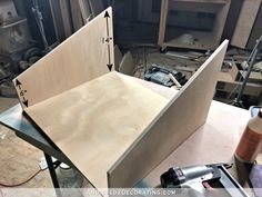 DIY pull-out slotted cookie sheet storage drawer - step 1 - cut bottom and attach slanted sides