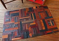 DIY Leather Belt Rug  Each piece is attached to a leather backing using a water based glue. After completing the leather belt rug I applied multiple coats of Pecards Antique leather restorer. This enriches the hues and protects the surface.