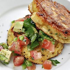 Summer corn cakes with chopped avocado and tomato salsa.
