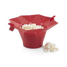 This revolutionary microwave popper makes up to 10 cups of crunchy corn in two to three minutes, with or without oil. Handy tabs serve as handles; the folding-top design pops open for snacking right out of the silicone bin. Heat-resistant red popper is dishwasher safe.