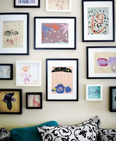Frame your kid's artwork and put it up! Gabe has so many great pieces :)
