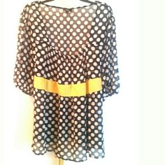 """Mossimo Plus Size 28/30 Black Polkadot Chiffon Top This Mossimo Plus Size 28/30 Black Polkadot Chiffon Top is in good used condition. So cute! Has a yellow faux belted waist / sash that ties in the back. 100% polyester Semi sheer fabric--best with a cami. Bust measures 26"""" across laying flat, measured from pit to pit, so 52"""" around. 28.5 inches long. ::: Bundle 3+ items from my closet and save 30% off when you use the app's Bundle feature! ::: No trades. Mossimo Supply Co Tops"""