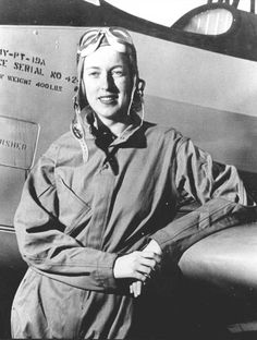 Cornelia Fort, one of the many US women pilots who ferried new planes from plant to airfield, and even across the Atlantic to England, posing with a PT-19 aircraft, date unknown.