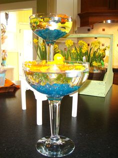 rubber duckie pond in a giant martini glass lined wth blue marbles. So cute!