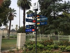 Sign post of sister cities at the front gate of the White Park.  Riverside, CA's first city park.