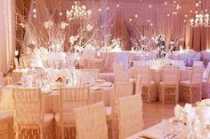 White birch branches adorned with feathers, white orchids, and crystals.Photo Credit: Dasha Wright Photography