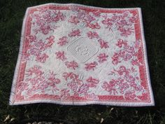 Heirloom quilted vintage tablecloth. $325.00, via Etsy.
