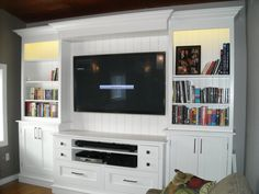 Entertainment centre we built. I love the lighting and tongue and groove backing
