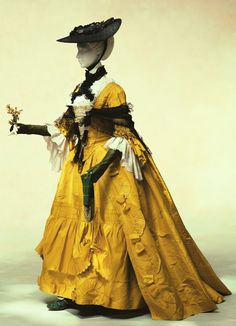 "Dress (robe à la française)   1760 A typical 18th century women's dress, ""robe à la française"". The colour has a golden shine, resonating with the glossy brilliance of the crisp silk. In early Christian culture, yellow was seen as the colour of heretics, and held in contempt until medieval times. In China, yellow was the colour of the Emperor, a colour so noble that commoners were forbidden its use. The 18th century vogue for ""chinoiserie"" amongst Europeans resulted in new interest in…"