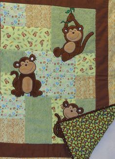 Soft flannel patchwork and appliqued quilt in monkey theme in greens, browns and yellows with just a touch of blue. 100% cotton fabrics