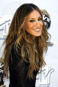 love her hair...makes me want to go dark again...with very wispy, sun-kissed highlights. Something to think about!