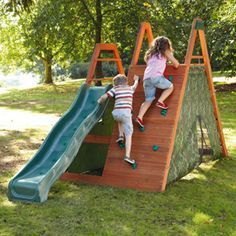 If it were a taller rock climber and longer slide - how fun!!! cute idea for the kids to have in the backyard #diyplayhouse