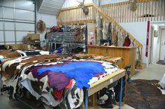 Hair on Cow Hides, Scraps, Fur Pelts, and more! This is a great shot of the front section of our store! www.theleatherguy.org