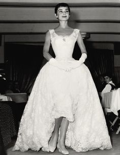 fuckyeshepburn:  Audrey does some guest modeling at a fashion show, Amsterdam, November 2nd, 1954.