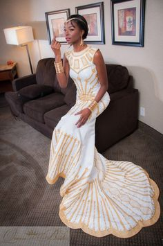 Affordable wedding gowns, maternity bridal dresses, african wedding clothing including veils and headpieces, bouquets and jewelry by TeKay Designs