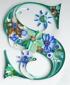 A gorgeous paper quilled letter - protect this kind of design from dust by framing it in a shadowbox