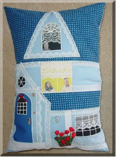 Pillow House. I would make flaps to open with button 'door knobs' and win do latches. I would make pockets for little doll to sleep