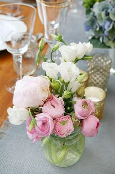 Sweet pink ranunculi look rustic when combined with white lisianthus in a mason jar.