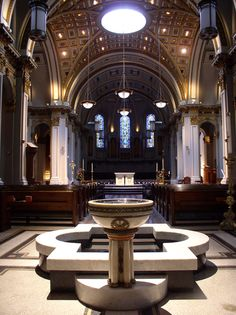 Baptismal font, nave, and altar at St. James Cathedral, Seattle, WA.